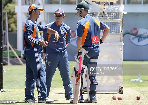 Ricky Ponting speaks with team mate Michael Clarke and batting coach Justin Langer during an Australian training session at Sydney Cricket Ground on...