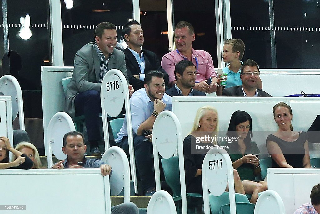 Ricky Ponting (c) watches proceedings from the stands during the round 13 A-League match between Sydney FC and the Central Coast Mariners at Allianz Stadium on December 27, 2012 in Sydney, Australia.