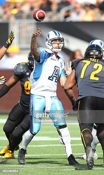 Ricky Ray of the Toronto Argonauts fires a pass in a CFL football game against the Hamilton Tigercats at Tim Hortons Field on September 1 2014 in...