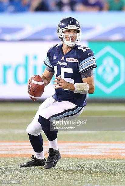 Ricky Ray of the Toronto Argonauts gets set to fire a pass against the Calgary Stampeders during a CFL game at the Rogers Centre on July 12 2014 in...