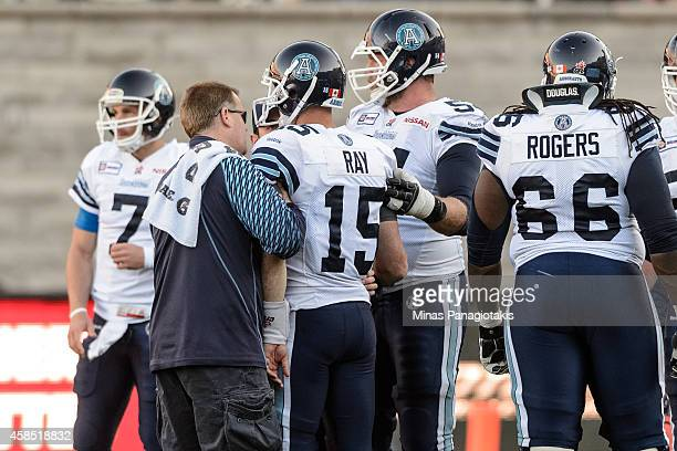 Ricky Ray of the Toronto Argonauts is helped off the field during the CFL game against the Montreal Alouettes at Percival Molson Stadium on November...