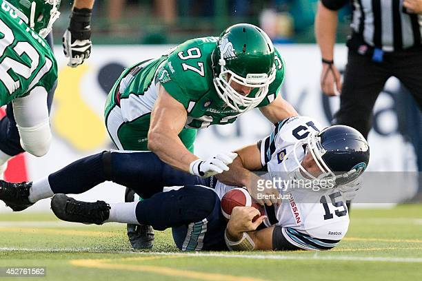 Ricky Ray of the Toronto Argonauts is sacked by John Chick of the Saskatchewan Roughriders in a game between the Toronto Argonauts and Saskatchewan...