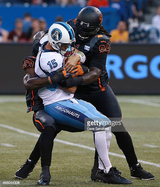 Ricky Ray of the Toronto Argonauts is sacked by Khreem Smith of the BC Lions and Alex Bazzie of the BC Lions during their game at Rogers Centre on...