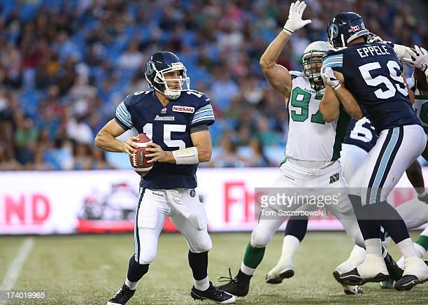 Ricky Ray of the Toronto Argonauts looks for a receiver as he moves in the pocket during CFL game action against the Saskatchewan Roughriders on July...