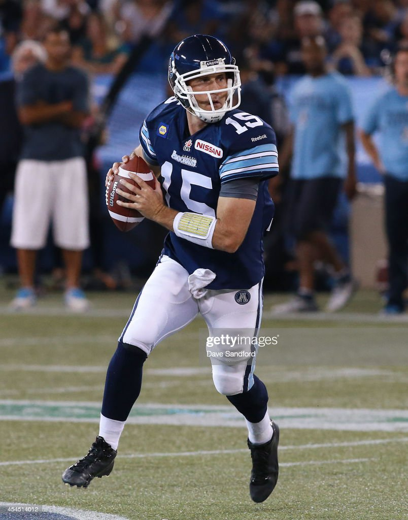 <a gi-track='captionPersonalityLinkClicked' href=/galleries/search?phrase=Ricky+Ray&family=editorial&specificpeople=4171123 ng-click='$event.stopPropagation()'>Ricky Ray</a> #15 of the Toronto Argonauts looks to make a pass against the Winnipeg Blue Bombers during their game at Rogers Centre on August 12, 2014 in Toronto, Ontario, Canada.