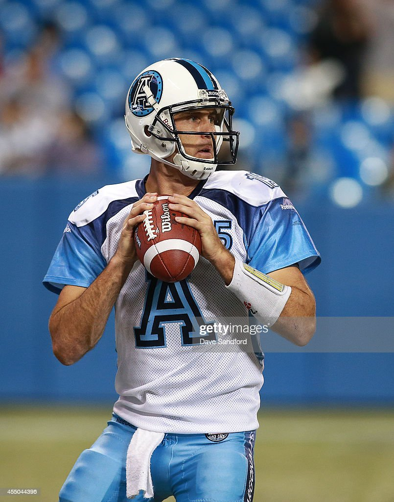 <a gi-track='captionPersonalityLinkClicked' href=/galleries/search?phrase=Ricky+Ray&family=editorial&specificpeople=4171123 ng-click='$event.stopPropagation()'>Ricky Ray</a> #15 of the Toronto Argonauts looks to make a pass against the BC Lions during their game at Rogers Centre on August 17, 2014 in Toronto, Canada.