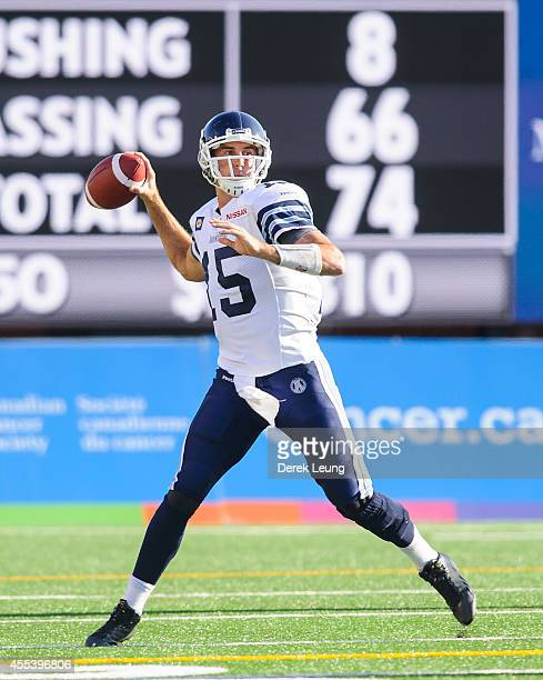 Ricky Ray of the Toronto Argonauts looks up field for a teammate to throw to during a CFL game against the Calgary Stampeders at McMahon Stadium on...