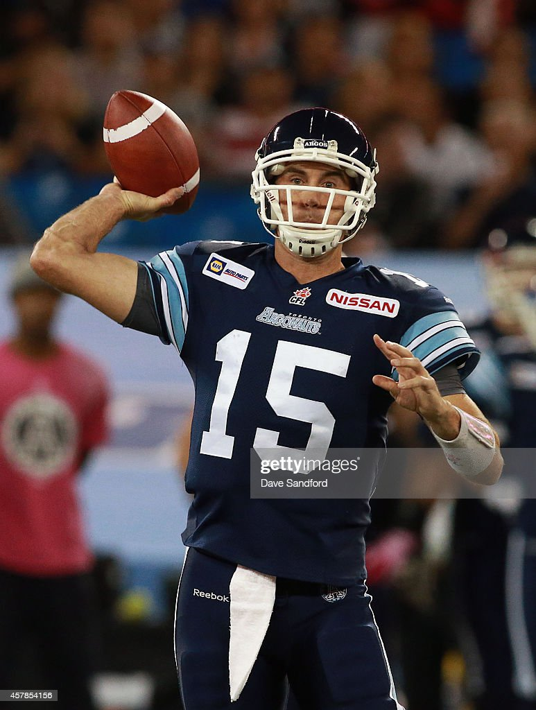 <a gi-track='captionPersonalityLinkClicked' href=/galleries/search?phrase=Ricky+Ray&family=editorial&specificpeople=4171123 ng-click='$event.stopPropagation()'>Ricky Ray</a> #15 of the Toronto Argonauts makes a pass against the Hamilton Tiger-Cats during their game at Rogers Centre on October 25, 2014 in Toronto, Canada.
