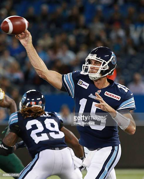 Ricky Ray of the Toronto Argonauts makes a pass as his team faces the Edmonton Eskimos during their game at Rogers Centre on October 4 2014 in...