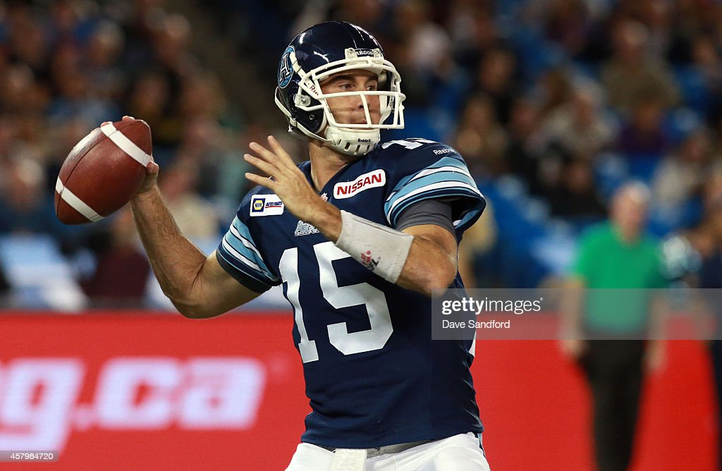 <a gi-track='captionPersonalityLinkClicked' href=/galleries/search?phrase=Ricky+Ray&family=editorial&specificpeople=4171123 ng-click='$event.stopPropagation()'>Ricky Ray</a> #15 of the Toronto Argonauts receives the ball from centre Jeff Keeping #67 of the Toronto Argonauts as they face the Hamilton Tiger-Cats during their game at Rogers Centre on October 10, 2014 in Toronto, Canada.