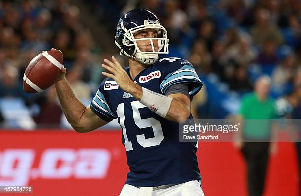 Ricky Ray of the Toronto Argonauts receives the ball from centre Jeff Keeping of the Toronto Argonauts as they face the Hamilton TigerCats during...