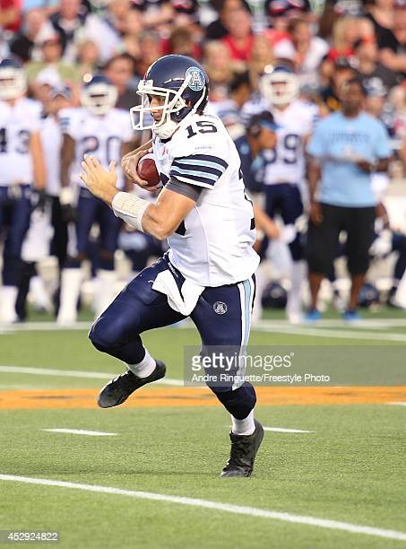 Ricky Ray of the Toronto Argonauts rushes against the Ottawa Redblacks during a CFL game at TD Place Stadium on July 18 2014 in Ottawa Ontario Canada