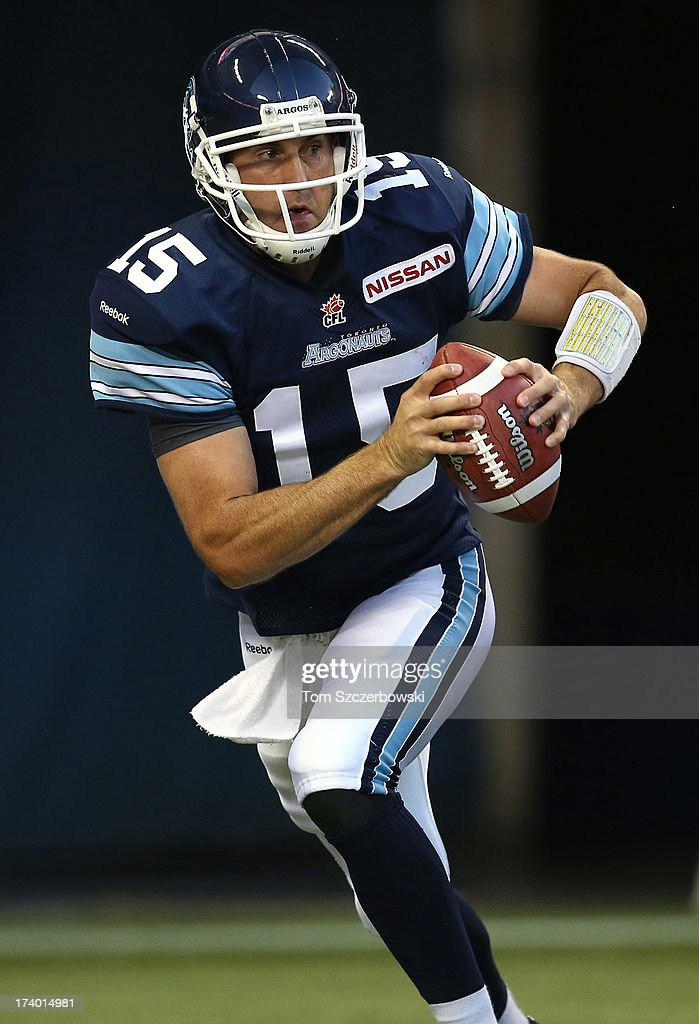 <a gi-track='captionPersonalityLinkClicked' href=/galleries/search?phrase=Ricky+Ray&family=editorial&specificpeople=4171123 ng-click='$event.stopPropagation()'>Ricky Ray</a> #15 of the Toronto Argonauts scrambles during CFL game action against the Saskatchewan Roughriders on July 11, 2013 at Rogers Centre in Toronto, Ontario, Canada.