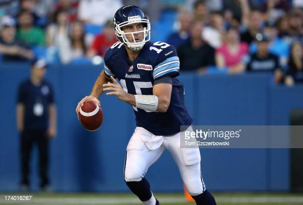 Ricky Ray of the Toronto Argonauts scrambles during CFL game action against the Saskatchewan Roughriders on July 11 2013 at Rogers Centre in Toronto...