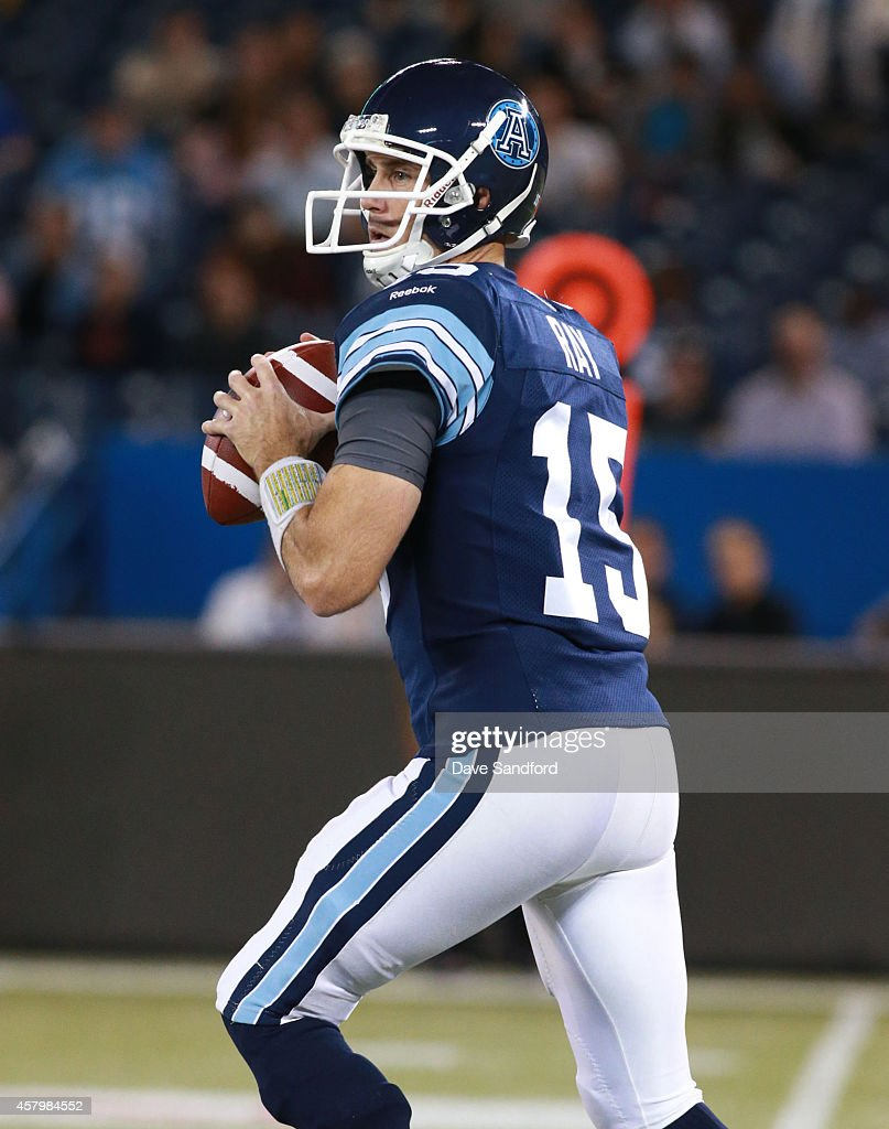 <a gi-track='captionPersonalityLinkClicked' href=/galleries/search?phrase=Ricky+Ray&family=editorial&specificpeople=4171123 ng-click='$event.stopPropagation()'>Ricky Ray</a> #15 of the Toronto Argonauts throws a pass against the Edmonton Eskimos during their game at Rogers Centre on October 4, 2014 in Toronto, Ontario, Canada.