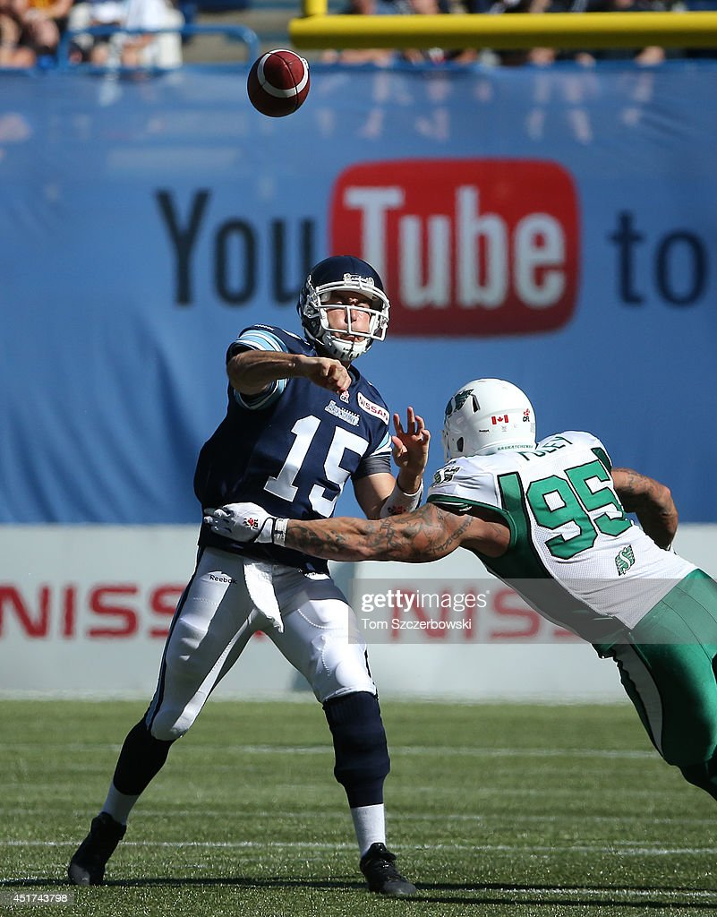 <a gi-track='captionPersonalityLinkClicked' href=/galleries/search?phrase=Ricky+Ray&family=editorial&specificpeople=4171123 ng-click='$event.stopPropagation()'>Ricky Ray</a> #15 of the Toronto Argonauts throws a pass while under pressure from Ricky Foley #95 of the Saskatchewan Roughriders during a CFL game on July 5, 2014 at Rogers Centre in Toronto, Ontario, Canada.