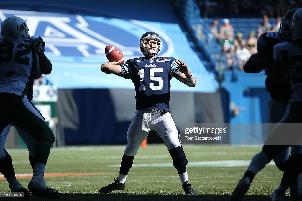 <a gi-track='captionPersonalityLinkClicked' href=/galleries/search?phrase=Ricky+Ray&family=editorial&specificpeople=4171123 ng-click='$event.stopPropagation()'>Ricky Ray</a> #15 of the Toronto Argonauts throws a touchdown pass during a CFL game against the Saskatchewan Roughriders on July 5, 2014 at Rogers Centre in Toronto, Ontario, Canada.