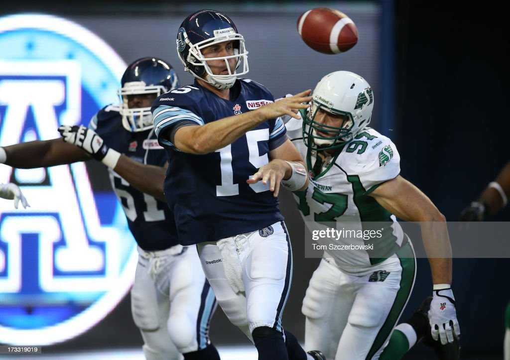 <a gi-track='captionPersonalityLinkClicked' href=/galleries/search?phrase=Ricky+Ray&family=editorial&specificpeople=4171123 ng-click='$event.stopPropagation()'>Ricky Ray</a> #15 of the Toronto Argonauts throws during CFL game action against the Saskatchewan Roughriders on July 11, 2013 at Rogers Centre in Toronto, Ontario, Canada.