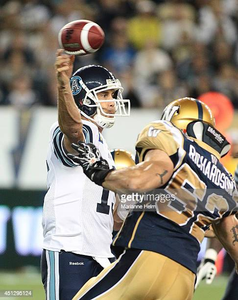 Ricky Ray of the Toronto Argonauts throws the ball under pressure in second half action in a CFL game against the Winnipeg Blue Bombers at Investors...