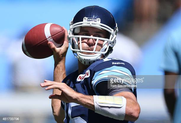Ricky Ray of the Toronto Argonauts warms up before the start of CFL game action against the Saskatchewan Roughriders on July 5 2014 at Rogers Centre...