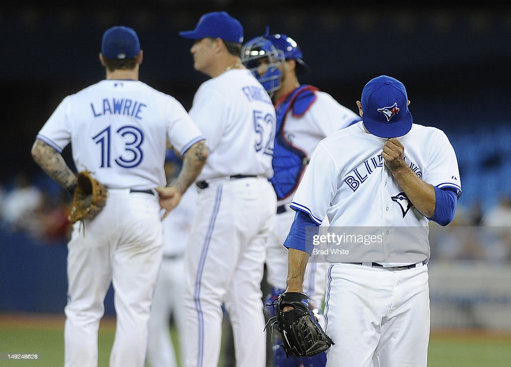 <a gi-track='captionPersonalityLinkClicked' href=/galleries/search?phrase=Ricky+Romero&family=editorial&specificpeople=809221 ng-click='$event.stopPropagation()'>Ricky Romero</a> #24 of the Toronto Blue Jays covers his face as he walks off the field after being pulled in the second inning as teammates <a gi-track='captionPersonalityLinkClicked' href=/galleries/search?phrase=Brett+Lawrie&family=editorial&specificpeople=5496694 ng-click='$event.stopPropagation()'>Brett Lawrie</a> #13, John Farrell and <a gi-track='captionPersonalityLinkClicked' href=/galleries/search?phrase=J.P.+Arencibia&family=editorial&specificpeople=4959430 ng-click='$event.stopPropagation()'>J.P. Arencibia</a> #9 look on during MLB game action against the Oakland Athletics July 25, 2012 at Rogers Centre in Toronto, Ontario, Canada.