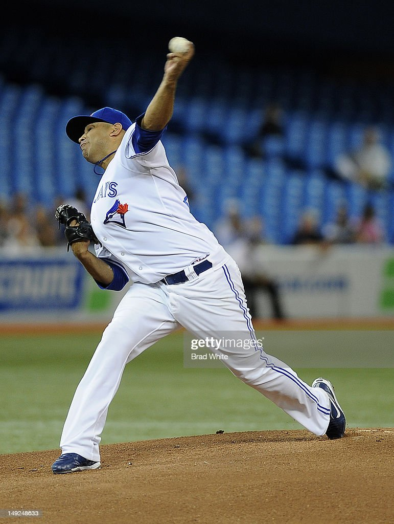 <a gi-track='captionPersonalityLinkClicked' href=/galleries/search?phrase=Ricky+Romero&family=editorial&specificpeople=809221 ng-click='$event.stopPropagation()'>Ricky Romero</a> #24 of the Toronto Blue Jays delivers a pitch during MLB game action against the Oakland Athletics July 25, 2012 at Rogers Centre in Toronto, Ontario, Canada.