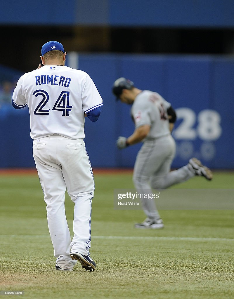 Ricky Romero #24 of the Toronto Blue Jays looks on as Travis Hafner #48 of the Cleveland Indians rounds the bases after hitting a home run during MLB game action July 13, 2012 at Rogers Centre in Toronto, Ontario, Canada.