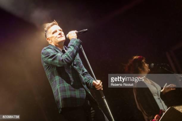 Ricky Ross and Lorraine McIntosh of Scottish pop rock band Deacon Blue perform on stage at Edinburgh Castle on July 22 2017 in Edinburgh Scotland