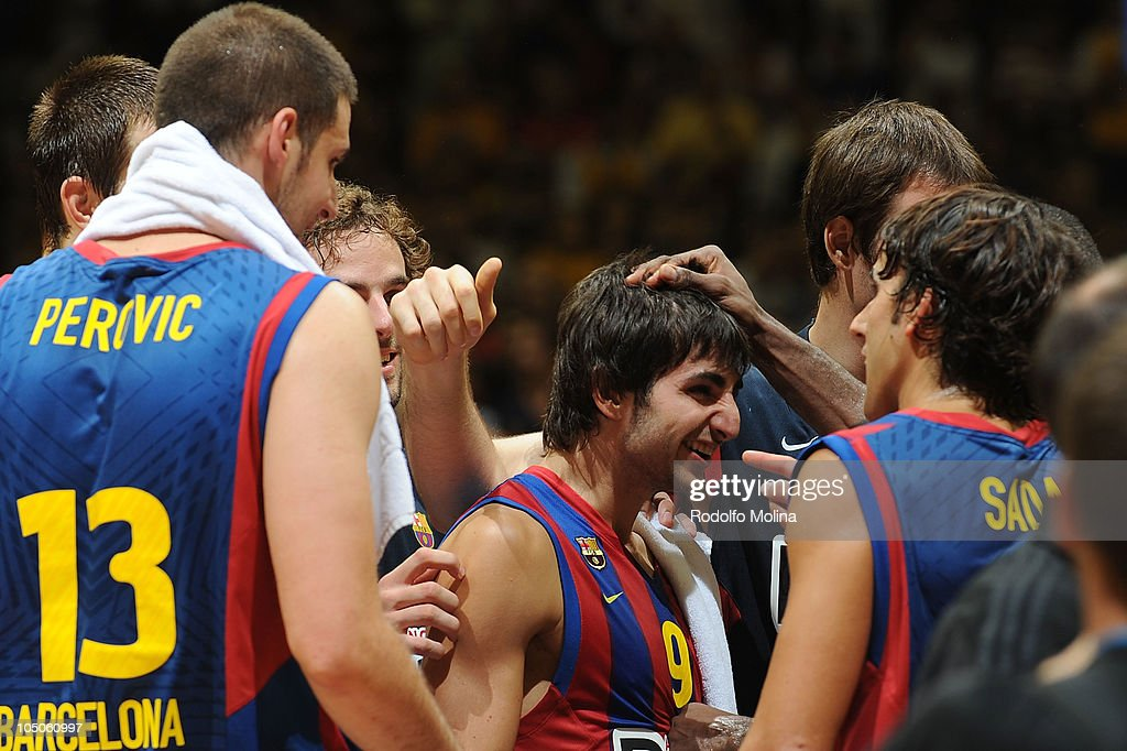 <a gi-track='captionPersonalityLinkClicked' href=/galleries/search?phrase=Ricky+Rubio&family=editorial&specificpeople=4028920 ng-click='$event.stopPropagation()'>Ricky Rubio</a>, #9 of Regal FC Barcelona celebrates with his teamates the victory at the end of the NBA Europe Live game between Regal FC Barcelona vs LA Lakers at Palau Sant Jordi on October 7, 2010 in Barcelona, Spain.