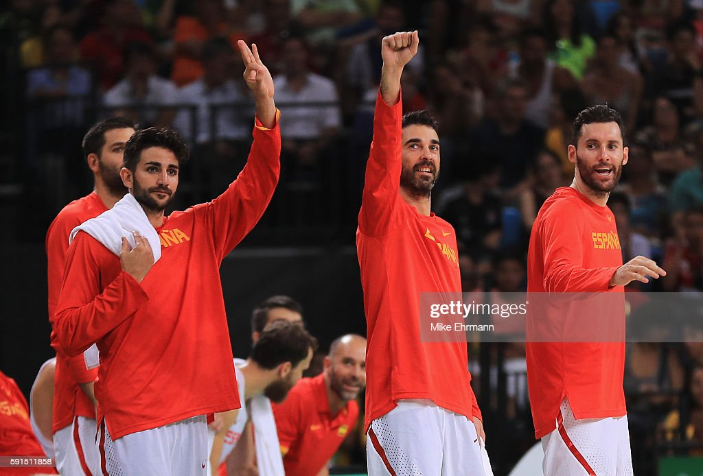 Ricky Rubio #79, Juan-Carlos Navarro #7 and Rudy Fernandez #5 of Spain celebrate on the bench during the Men's Quarterfinal match against France on Day 12 of the Rio 2016 Olympic Games at Carioca Arena 1 on August 17, 2016 in Rio de Janeiro, Brazil.