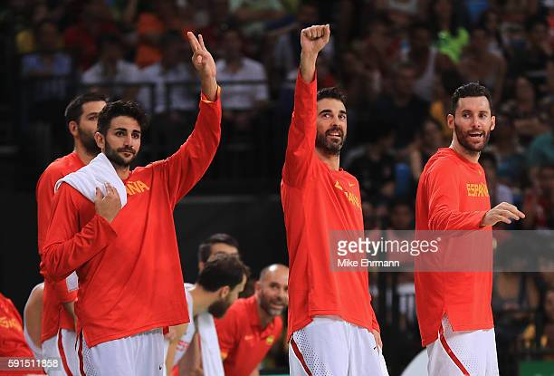 Ricky Rubio JuanCarlos Navarro and Rudy Fernandez of Spain celebrate on the bench during the Men's Quarterfinal match against France on Day 12 of the...
