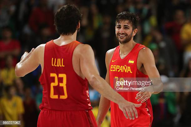 Ricky Rubio of Spain and Sergio Llull of Spain celebrate winning the Men's Basketball Bronze medal game between Australia and Spain on Day 16 of the...