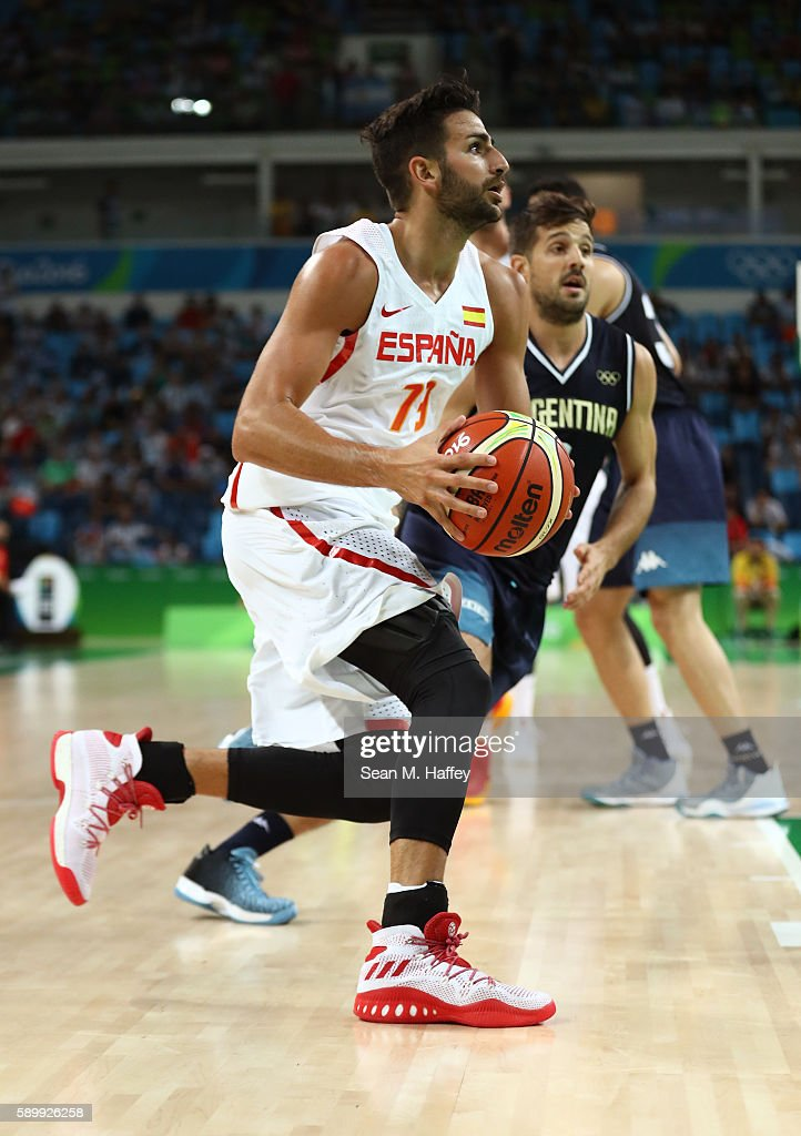 Ricky Rubio of Spain drives the ball against Nicolas Laprovittola of Argentina during a Men's Basketball Preliminary Round Group B game between Spain...