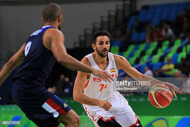 Ricky Rubio of Spain handles the ball against Tony Parker of France during the Men's Quarterfinal match on Day 12 of the Rio 2016 Olympic Games at...