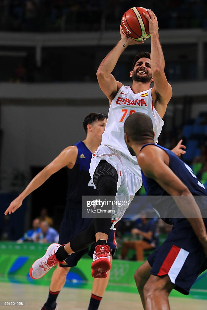Ricky Rubio of Spain puts up a shot over Tony Parker of France during the Men's Quarterfinal match on Day 12 of the Rio 2016 Olympic Games at Carioca...