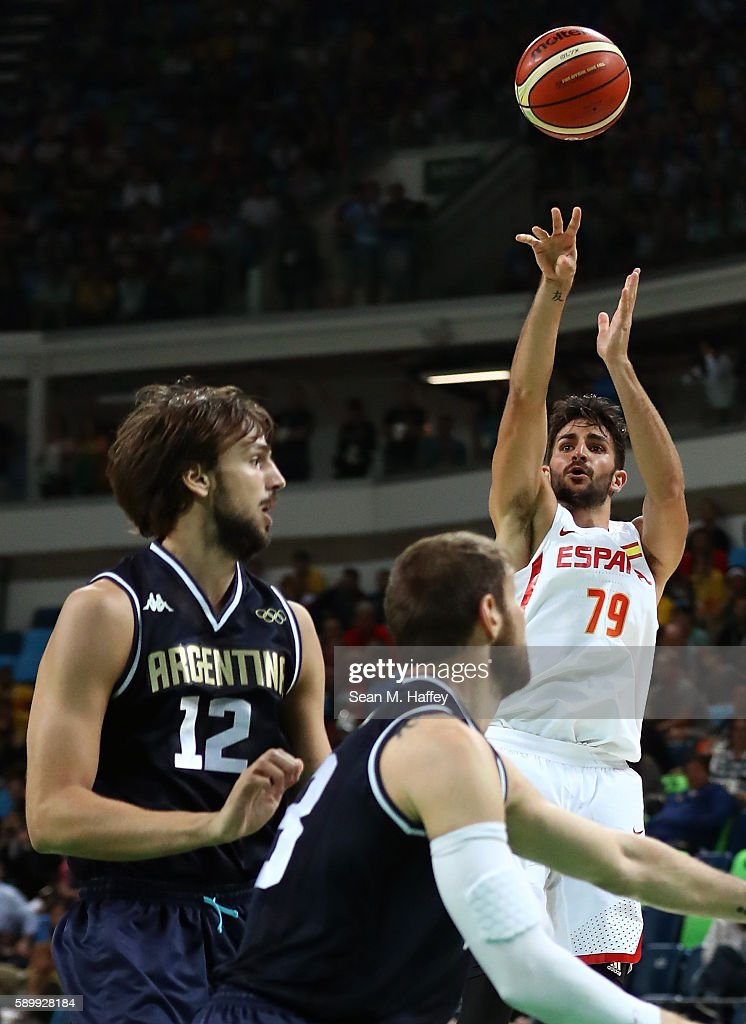 Ricky Rubio of Spain shoots against Marcos Delia and Nicolas Laprovittola of Argentina during a Men's Basketball Preliminary Round Group B game...