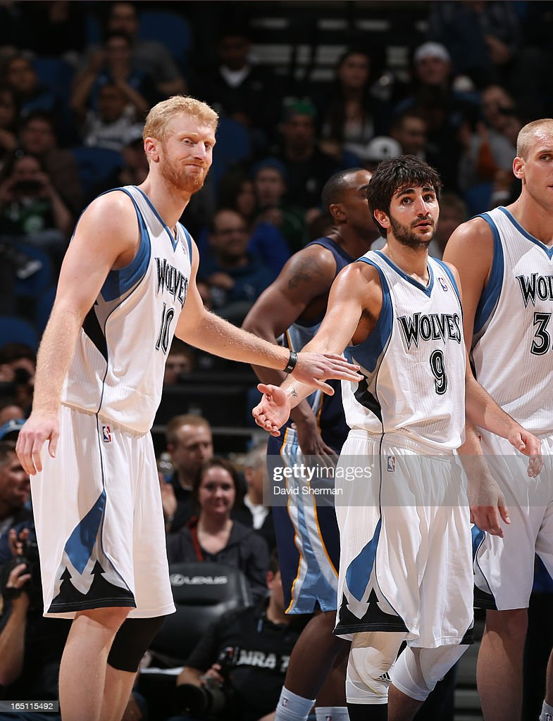Ricky Rubio #9 of the Minnesota Timberwolves and Chase Budinger #10 of the Minnesota Timberwolves congratulate each other during the game between the Memphis Grizzlies and the Minnesota Timberwolves on March 30, 2013 at Target Center in Minneapolis, Minnesota.