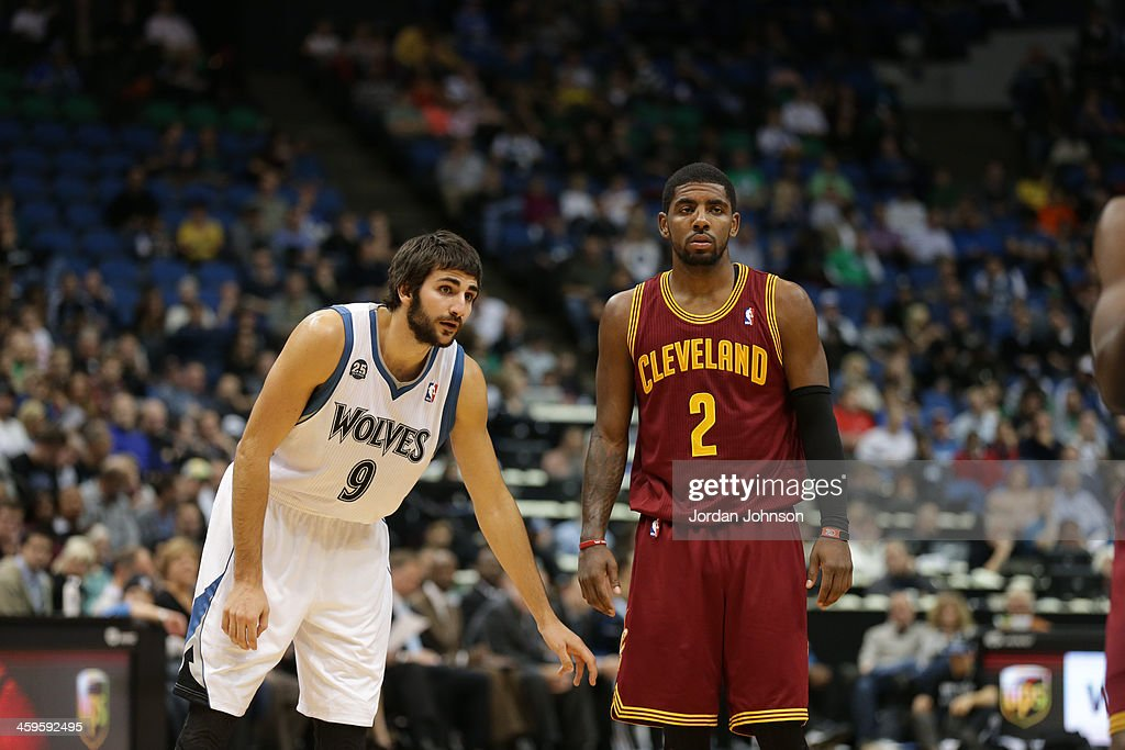 Ricky Rubio #9 of the Minnesota Timberwolves and Kyrie Irving #2 of the Cleveland Cavaliers stand on the court on November 13, 2013 at Target Center in Minneapolis, Minnesota.