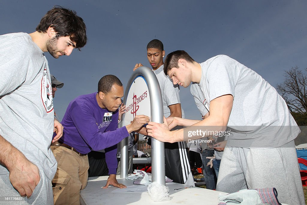 Ricky Rubio #9 of the Minnesota Timberwolves, Anthony Davis #23 of the New Orleans Hornets and Nikola Vucevic #9 of the Orlando Magic put together a sign at the 2013 NBA Cares Day of Service at the Playground Build with KABOOM! on February 15, 2013 in Houston, Texas.