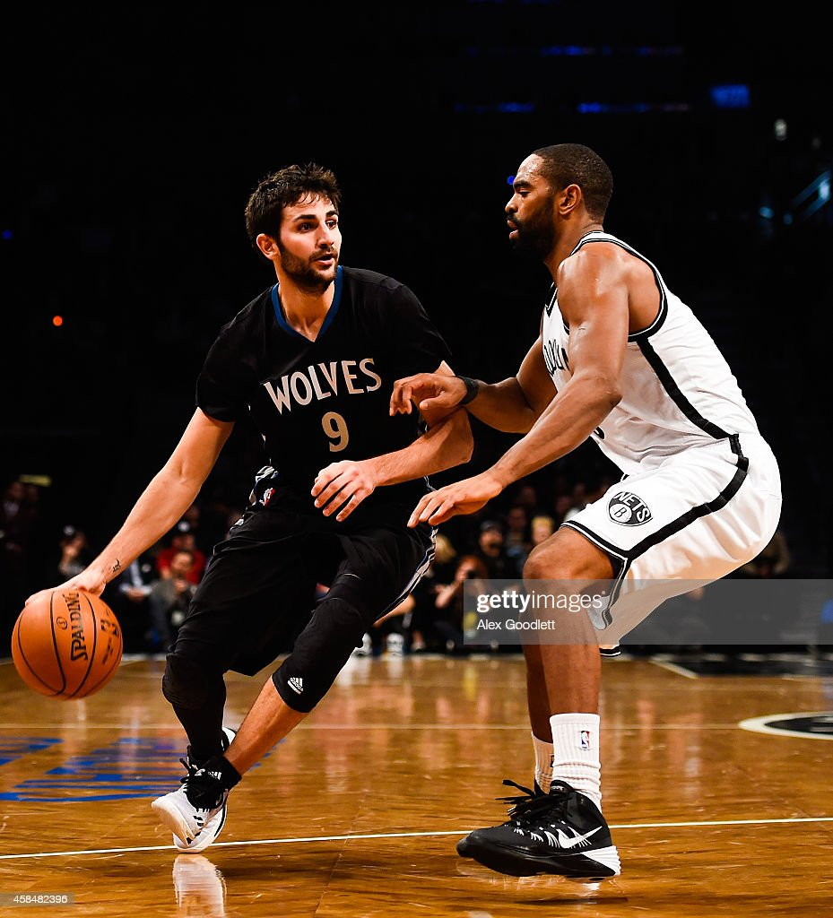 Ricky Rubio #9 of the Minnesota Timberwolves attempts to drive around Alan Anderson #6 of the Brooklyn Nets in the third quarter at the Barclays Center on November 5, 2014 in the Brooklyn borough of New York City.