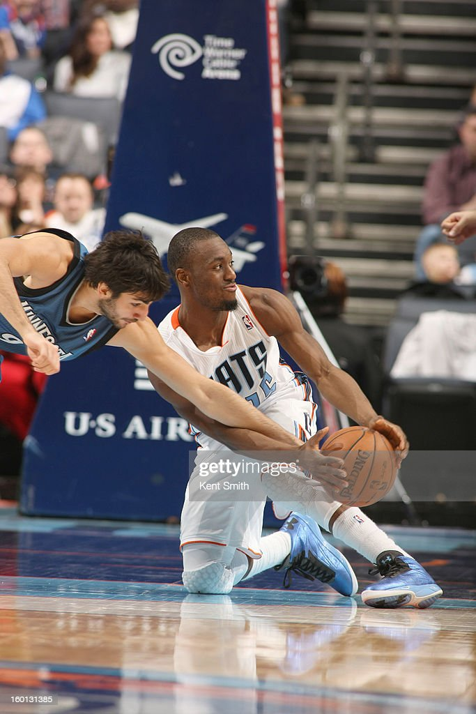 Ricky Rubio #9 of the Minnesota Timberwolves battles for the ball control with Kemba Walker #15 of the Charlotte Bobcats at the Time Warner Cable Arena on January 26, 2013 in Charlotte, North Carolina.