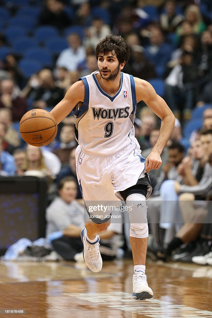 <a gi-track='captionPersonalityLinkClicked' href=/galleries/search?phrase=Ricky+Rubio&family=editorial&specificpeople=4028920 ng-click='$event.stopPropagation()'>Ricky Rubio</a> #9 of the Minnesota Timberwolves brings the ball up court against the San Antonio Spurs on February 6, 2013 at Target Center in Minneapolis, Minnesota.