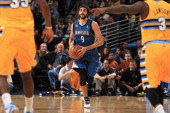 Ricky Rubio of the Minnesota Timberwolves controls the ball against the Denver Nuggets at Pepsi Center on November 15 2013 in Denver Colorado The...