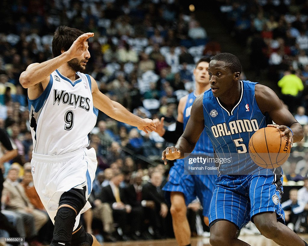 Ricky Rubio #9 of the Minnesota Timberwolves defends against Victor Oladipo #5 of the Orlando Magic during the game on October 30, 2013 at Target Center in Minneapolis, Minnesota.