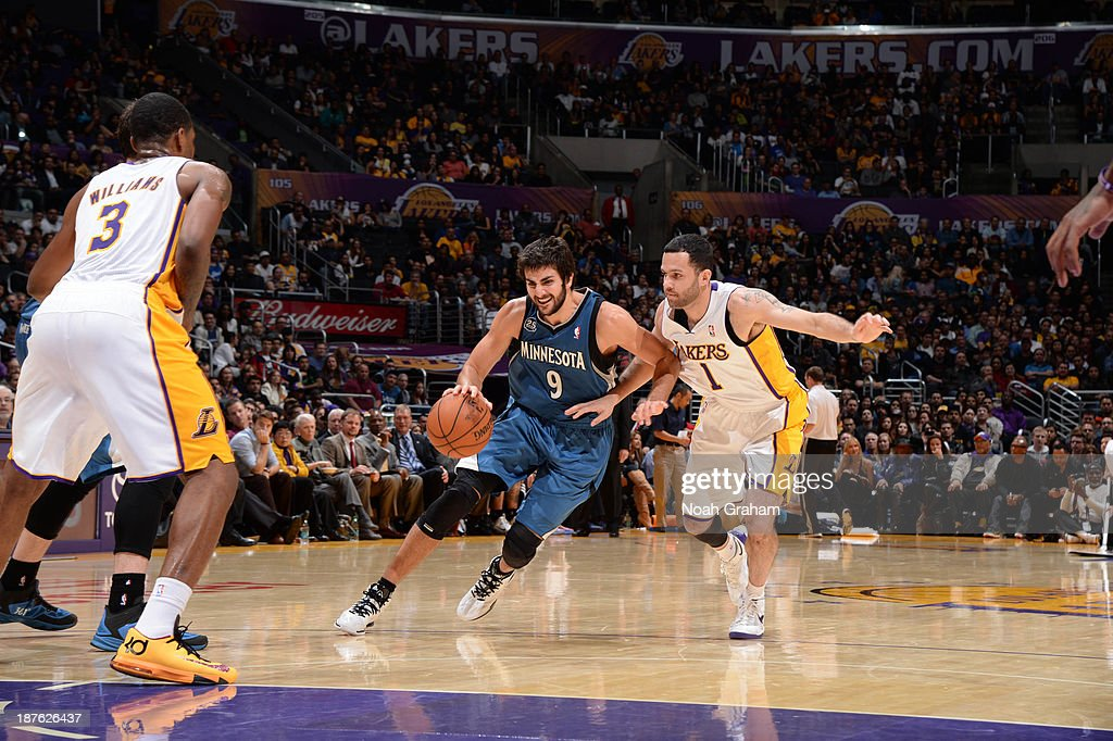 <a gi-track='captionPersonalityLinkClicked' href=/galleries/search?phrase=Ricky+Rubio&family=editorial&specificpeople=4028920 ng-click='$event.stopPropagation()'>Ricky Rubio</a> #9 of the Minnesota Timberwolves dribbles against <a gi-track='captionPersonalityLinkClicked' href=/galleries/search?phrase=Jordan+Farmar&family=editorial&specificpeople=228137 ng-click='$event.stopPropagation()'>Jordan Farmar</a> #1 of the Los Angeles Lakers at Staples Center on November 10, 2013 in Los Angeles, California.
