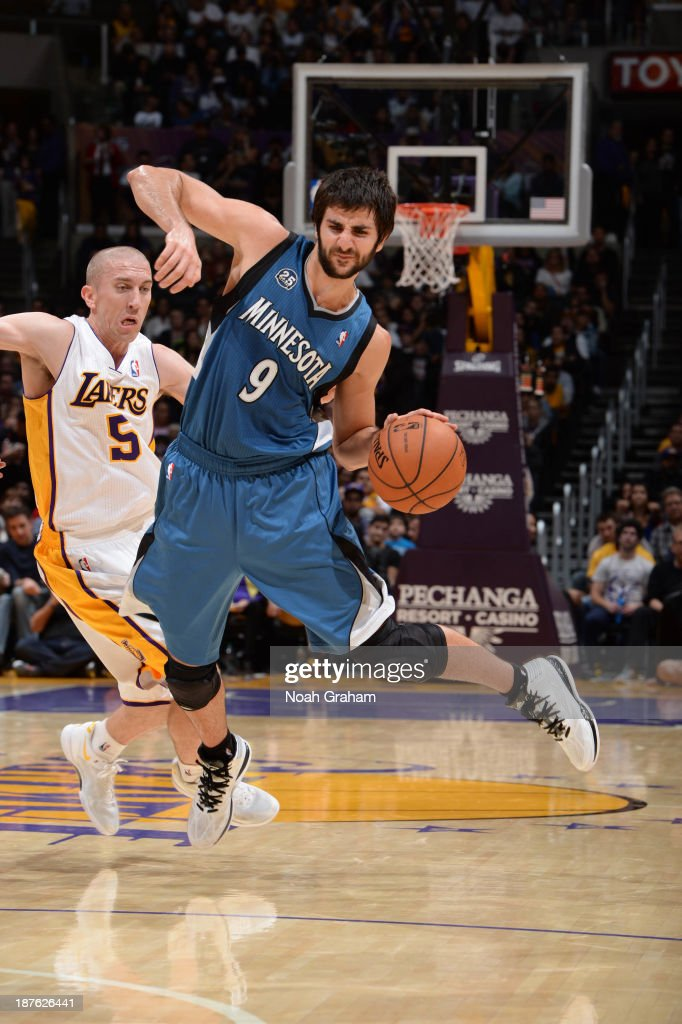 <a gi-track='captionPersonalityLinkClicked' href=/galleries/search?phrase=Ricky+Rubio&family=editorial&specificpeople=4028920 ng-click='$event.stopPropagation()'>Ricky Rubio</a> #9 of the Minnesota Timberwolves dribbles past <a gi-track='captionPersonalityLinkClicked' href=/galleries/search?phrase=Steve+Blake+-+Basketball+Player&family=editorial&specificpeople=204474 ng-click='$event.stopPropagation()'>Steve Blake</a> #5 of the Los Angeles Lakers at Staples Center on November 10, 2013 in Los Angeles, California.