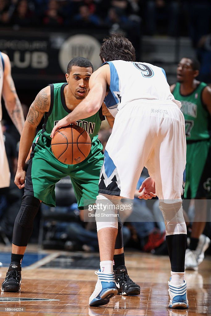 <a gi-track='captionPersonalityLinkClicked' href=/galleries/search?phrase=Ricky+Rubio&family=editorial&specificpeople=4028920 ng-click='$event.stopPropagation()'>Ricky Rubio</a> #9 of the Minnesota Timberwolves dribbles the ball against Jeff Green #8 of the Boston Celtics during the game on April 1, 2013 at Target Center in Minneapolis, Minnesota.