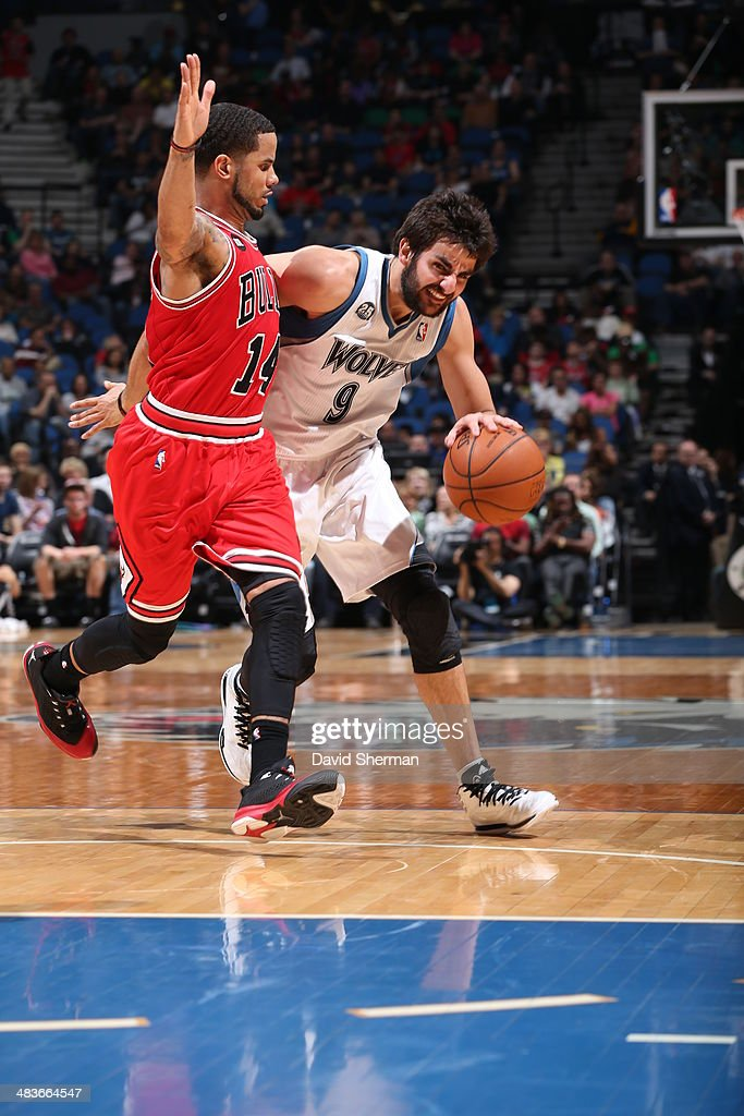 Ricky Rubio #9 of the Minnesota Timberwolves dribbles the ball against the Chicago Bulls during the game on April 9, 2014 at Target Center in Minneapolis, Minnesota.