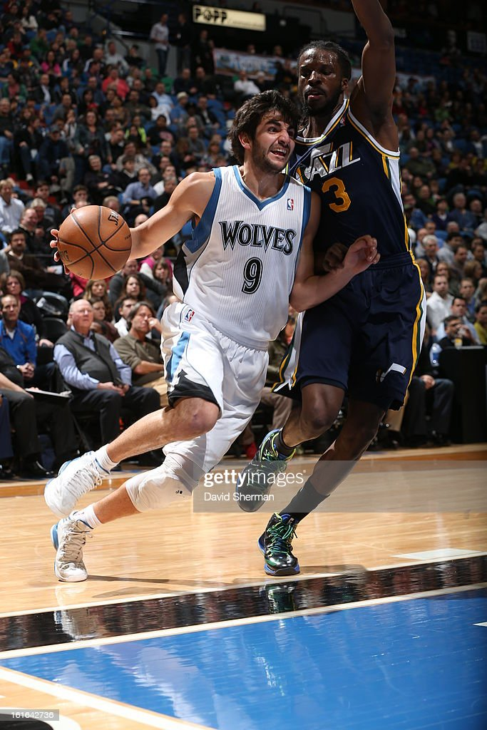 Ricky Rubio #9 of the Minnesota Timberwolves drives against DeMarre Carroll #3 of the Utah Jazz on February 13, 2013 at Target Center in Minneapolis, Minnesota.