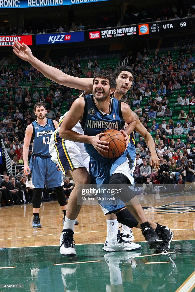 Ricky Rubio #9 of the Minnesota Timberwolves drives against Enes Kanter #0 of the Utah Jazz at EnergySolutions Arena on February 22, 2014 in Salt Lake City, Utah.